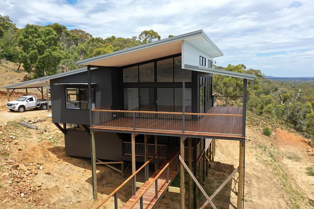 custom built timber pole home Mt Richon
