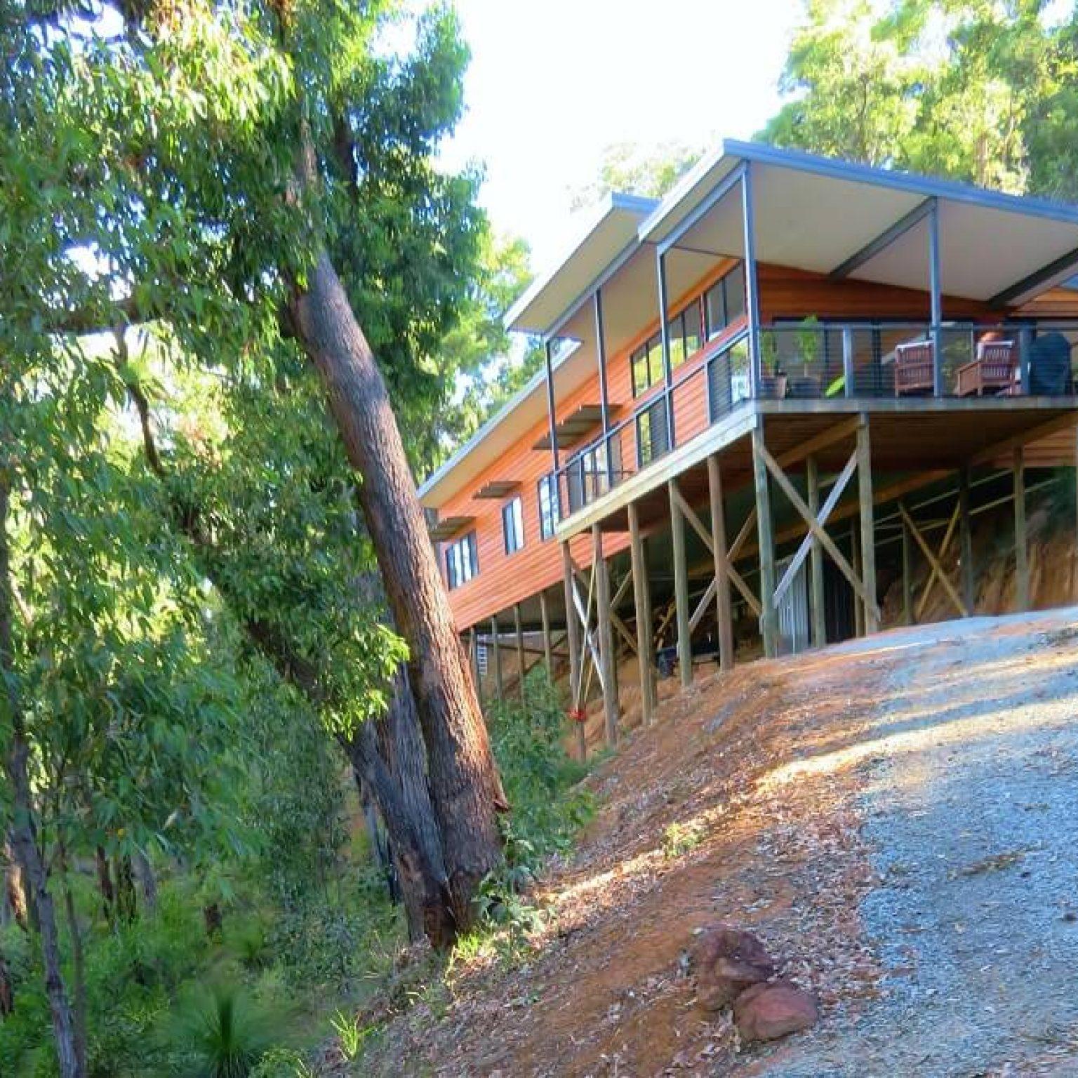 Custom built Cedar and Colorbond pole home on a steep site in Kalamunda