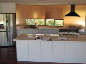 Custom Copper splashback installed in the kitchen